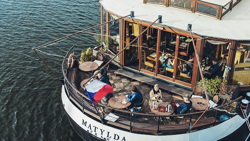 11 Day-and-night-men-travel-prague-boat-on-vlatva-river