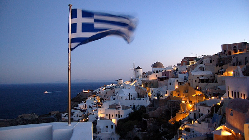 16 Luxury-Action-men-travel-greece-greak-islands-santorini-greek-flag