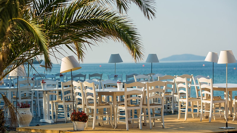 17 Luxury-Action-men-travel-greece-greak-islands-empty-beach-restaurant